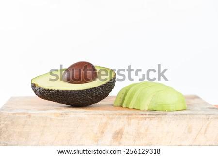 Closed up half of Avocado fruit on white - stock photo