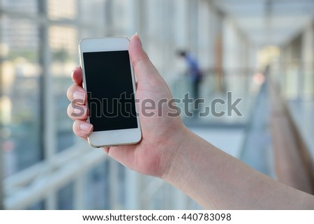 Closed up hand of man using smartphone  - stock photo