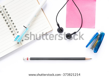 closed-up isolated flat lay of educational equipment - stock photo