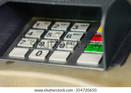 Closed up keyboard of an ATM (Automated teller machine) - stock photo