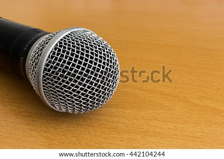 closed up microphone on wooden table