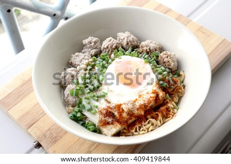 Closed up Noodle soup with minced pork and onion
