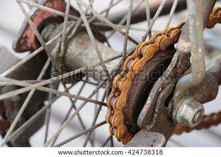 Closed up of rusty bicycle rear wheel, include chain, chain ring,  - stock photo