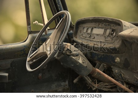 Closed up of the interior an abandoned car vintage style - stock photo
