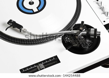Closed up of white turntable with white vinyl - stock photo