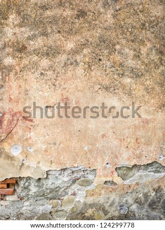 Closed-up photo of an aged dirty wall in Tuscany, Italy
