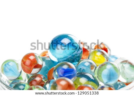 Closed up pile of assorted marbles - stock photo