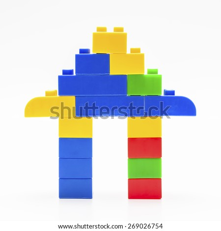 Closed up plastic building blocks with shape of house - stock photo