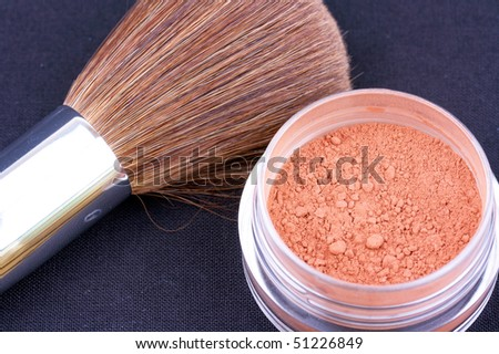 Closed-up powder and brush on black - stock photo