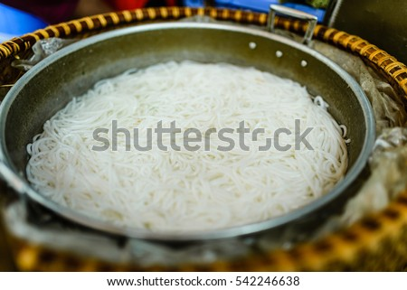 Closed up rice noodles in boiling water, noodles mixed materials. popular food in Vietnam