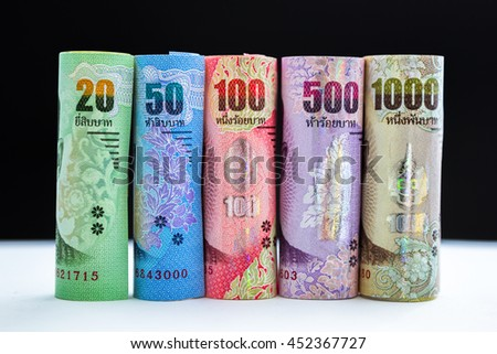 Closed up rolls Thai Baht banknote, Thai Baht currency money. Banknotes stacked on each other in different positions