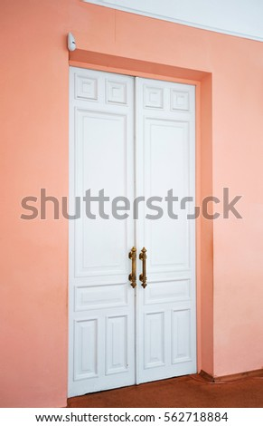 Closed White Door On Peach Orange Wall With Frame, Top View