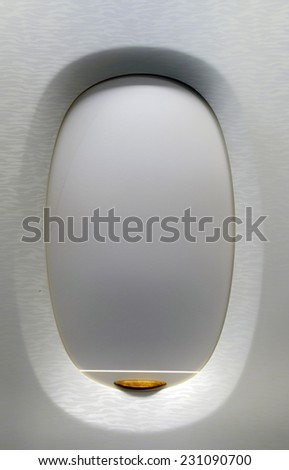 closed window in modern jet airplane - stock photo