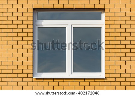 Closed window in the new building at sunset. - stock photo