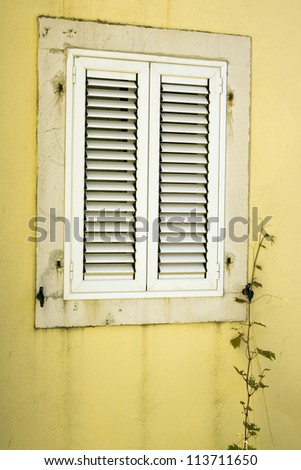 Closed window in the old house in Montenegro