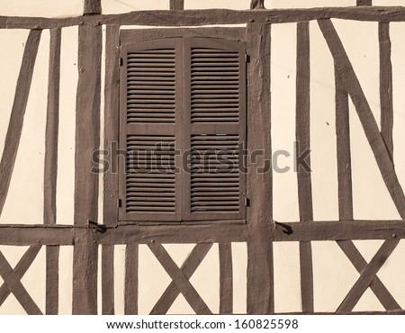 Closed window of timber frame building in Lyons la foret, eure, upper normandy, France - stock photo