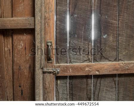Closed wooden door inside old garner - stock photo