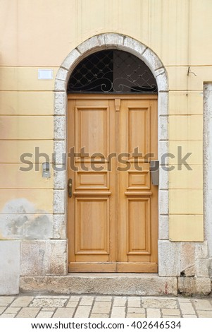 Closed Wooden Door With Arch at House