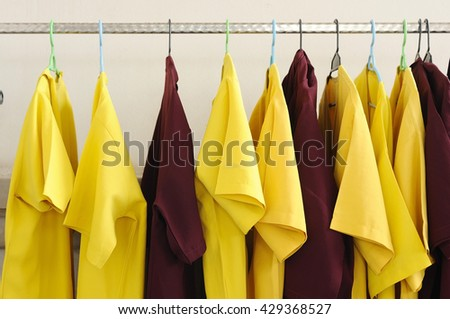 Closet rack with yellow and Crimson red.