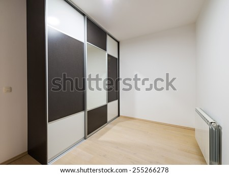 closet with sliding doors, drawer and shelves - stock photo