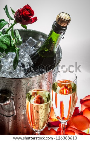 Closeu of red rose and cold champagne for Valentine's Day - stock photo