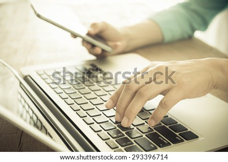 closeup a hand push keybord. technology concept , shopping online concept, communication concept. - stock photo