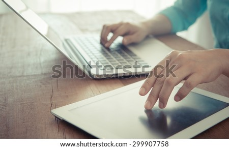closeup a hand  touch-screen tablet computer. technology concept, communication concept - stock photo