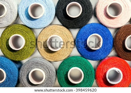 Closeup, a lot of colorful sewing thread, details