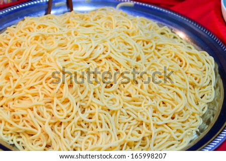 Closeup abstract background of coiled strands of spaghetti pasta