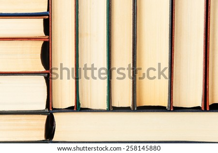 Closeup abstract background of stacked on each other old books - stock photo