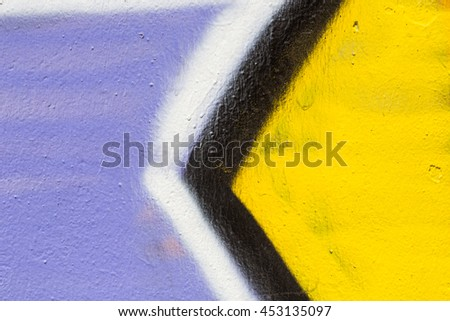 Closeup abstract painted wall of the city. Street art graffiti creative colors urban culture.