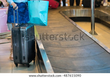 Closeup airline passenger suitcase at conveyor belt at airport