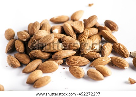 closeup almand nuts on a white background