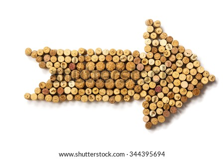 Closeup Arrow made of used wine corks. A random selection of used wine corks, some with vintage years - stock photo