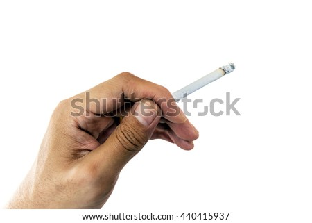 Closeup at cigarette in hand isolated on white background;Concept for World No Tobacco Day.