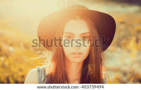 closeup attractive beautiful brunette woman with long fluffy hairs, closed face, sadness pain fear, despondency,mood, sadness,outdoor portrait sunset light, hipster style - stock photo