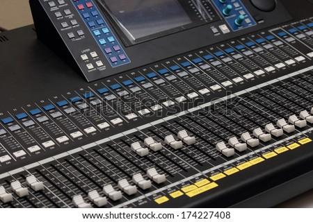 Closeup audio Mixer big studios. - stock photo