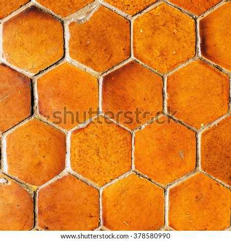 Closeup background image of hexagonal clay tiles  - stock photo