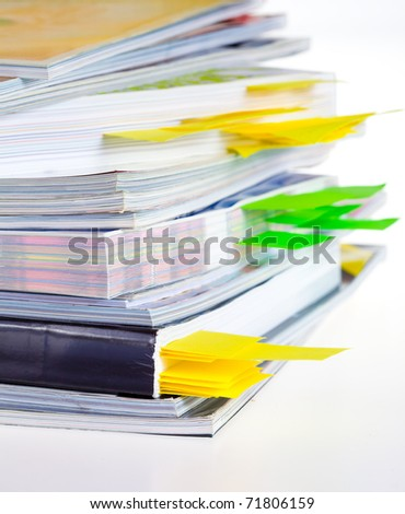 Closeup background of a pile of old magazines - stock photo