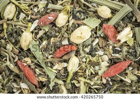 Closeup background of an immune system herbal tea including chrysanthemum and jasmine flower, lemon grass, ginko tea,, Buddha tea, wolfberry and balsam pear. - stock photo