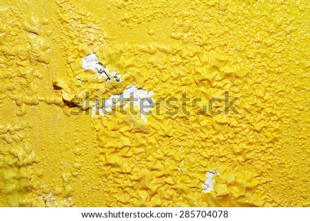 Closeup background of yellow wooden surface after paint remover - stock photo