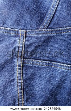 Closeup background texture of denim fabric. - stock photo