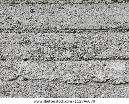 Closeup background texture of gray rough concrete wall - stock photo