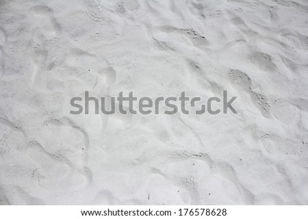 Closeup background view of ninety-nine percent fine grain powdery white gray quartz Siesta Beach, Florida sand outside on a sunny day.  - stock photo