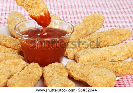 closeup BBQ sauce with chicken fingers - stock photo