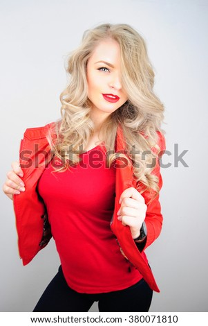 Closeup beautiful blonde woman portrait, rock style. Dressed in a red leather jacket - stock photo