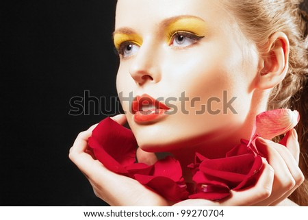 closeup beautiful blonde woman with leaf of red rose. Creative make-up. - stock photo