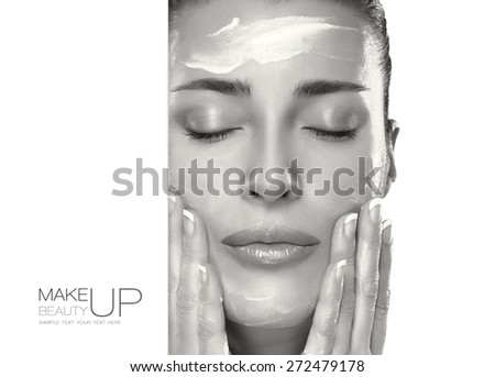 Closeup beautiful healthy young woman applying moisturizer in her clean face. Skin care concept. Spa Treatment. Template design with sample text - stock photo