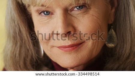 Closeup beautiful mature woman looking at camera
