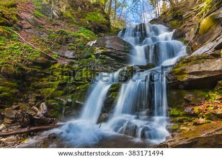closeup beautiful mountain waterfall - stock photo